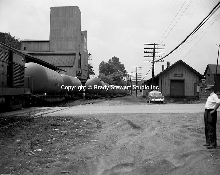 Oakdale PA - View of the PA Railroad train station.  Brady Stewart Sr observing the on location photography shoot - 1957.