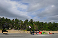Mar. 10, 2012; Gainesville, FL, USA; NHRA top fuel dragster driver Terry McMillen during qualifying for the Gatornationals at Auto Plus Raceway at Gainesville. Mandatory Credit: Mark J. Rebilas-