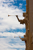 Two 48 foot tall herald angels with trumpets on the facade of Bass Performance Hall in Fort Worth, Texas.