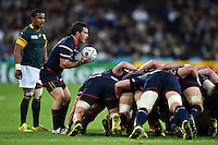 Niku Kruger of the USA looks to put the ball into a scrum. Rugby World Cup Pool B match between South Africa and the USA on October 7, 2015 at The Stadium, Queen Elizabeth Olympic Park in London, England. Photo by: Patrick Khachfe / Onside Images