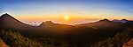 Panorama view of Flores sunset over fog bank, showing Mount Inerie and eroded volcanoes