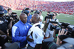 UK's first year head coach Joker Phillips and UofL's first year head coach Charlie Strong shake hands after UK's 23-16 win at Papa John's Cardinal Stadium on Saturday, Sept. 4, 2010. Photo by Scott Hannigan | Staff
