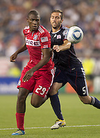 Chicago Fire forward Cristian Nazarit (29) and New England Revolution defender A.J. Soares (5) battle for head ball. In a Major League Soccer (MLS) match, the New England Revolution tied the Chicago Fire, 1-1, at Gillette Stadium on June 18, 2011.