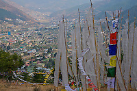 View over Thimphu with prayer flags in the foreground, Bhutan
