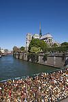 View of Notre Dame from Archbishop's Bridge (Pont de L'Archeveche, covered in locks, Paris, France