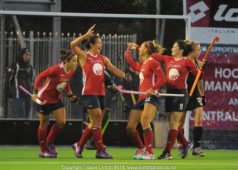 The USA team celebrates their second goal during the international women's hockey match between the NZ Black Sticks and USA at Endeavour Twin Turfs, Palmerston North, New Zealand on Thursday, 23 October 2014. Photo: Dave Lintott / lintottphoto.co.nz