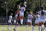 23 October 2016: Wake Forest's Bayley Feist (9) heads the ball over Notre Dame's Shannon Hendricks (11). The Wake Forest University Demon Deacons hosted the University of Notre Dame Fighting Irish at Spry Stadium in Winston-Salem, North Carolina in a 2016 NCAA Division I Women's Soccer match. Notre Dame won the game 1-0.