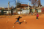 Locals play a morning game of soccer on a dirt pitch in Alexandra Township in Johannesburg, South Africa, during the 2010 World Cup.