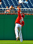 8 June 2008: Washington Nationals' infielder Cristian Guzman makes an over-the-shoulder catch against the San Francisco Giants at Nationals Park in Washington, DC. The Nationals dropped the afternoon matchup to the Giants 6-3 in their third consecutive loss of the 4-game series...Mandatory Photo Credit: Ed Wolfstein Photo