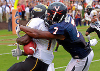 Virginia Cavaliers safety Corey Mosley (7) defends Southern Miss Golden Eagles wide receiver Tracy Lampley (1) during the game at Scott Stadium. Virginia was defeated 30-24. (Photo/Andrew Shurtleff)