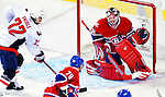 10 February 2010: Montreal Canadiens' goaltender Carey Price makes a first period chst pad save against the Washington Capitals at the Bell Centre in Montreal, Quebec, Canada. The Canadiens defeated the Capitals 6-5 in sudden death overtime, ending Washington's team-record winning streak at 14 games. Mandatory Credit: Ed Wolfstein Photo