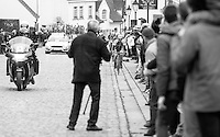 an older bystander finds himself in a bad position for taking his souvenir race photo as an elite group of riders storm up Nokere Berg via the gutter<br /> <br /> 69th Kuurne-Brussel-Kuurne 2017 (1.HC)