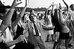 AT THE RACES, At the end of the day, punters sing and dance to a band on the Warwick Farm racecourse, near Sydney, Australia.