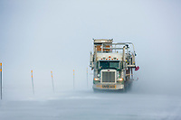 Semi tractor trailer hauls supplies across the snowy arctic north slope, James Dalton Highway (Haul Road).
