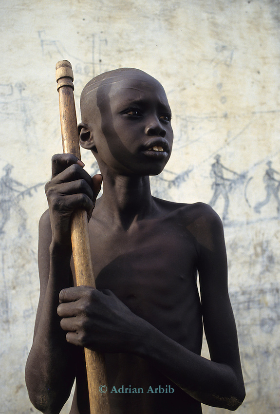 A Dinka boy barely able to stand due to starvation at Thiet feeding camp in Southern Sudan. Hundreds of Dinka tribes people having had their villages bombed and burnt  by the Khartoum forces  have travelled hundreds of miles to  avoid  hunger and death.
