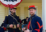 "Old Bethpage, New York, USA. August 30, 2015. L-R at front, ANDREW PREBLE from Long Beach, and MATT DELLINGER from Brooklyn, portray American Civil War soldiers from the 14th Brooklyn Regiment (14th New York State Militia) AKA The Brooklyn Chasseurs, at the Noon Inn tavern during the Old Time Music Weekend at the Old Bethpage Village Restoration. During their historical reenactments, members of the non-profit 14th Brooklyn Company E wear accurate reproductions of ""The ""Red Legged Devils"" original Union army uniform."