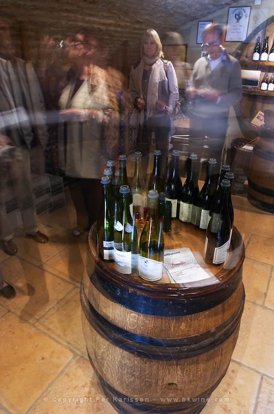 bottles in the tasting room people tasting dom h & g buisson st romain cote de beaune burgundy france