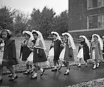 Bethel Park PA:  View of young catholic girls walking to church to receive their first holy communion at Saint Valentine's Church in Bethel Park PA - 1954.  Cathy Stewart was part of the class that received their first holy communion in 1954.  St Valentine's school opened in 1953 and is still in operation today.  Brady and Cathy Stewart attended the school from 1st thru 8th grades.  Michael Stewart attended from 1st thru 3rd grades.