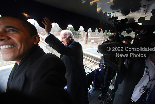 Edgewood, MD- January 17, 2009 -- United States Vice President-elect Joseph Biden, right, and United States President-elect Barack Obama, left, during the second slow roll near Edgewood station, old Edgewood road off of US Rt. 40, Edgewood, Maryland on the way to Baltimore, Maryland during Whistle Stop tour on Saturday, January 17, 2009.  .Credit: Chang W. Lee - Pool via CNP