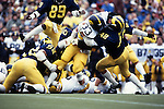 Michigan Wolverines linebacker Mike Mallory tackles an Iowa Hawkeyes running back during the Homecoming Game at Michigan Stadium in Ann Arbor, Michigan on 10/22/83.  Michigan defeated Iowa 16-13. Photo by John D. Hanlon, 25-year photographer for Sports Illustrated.