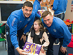 St Johnstone players visit Fairview School in Perth.....19.12.13<br /> Rebecca Keen is given a selection box by Gary Miller and Paddy Cregg<br /> Picture by Graeme Hart.<br /> Copyright Perthshire Picture Agency<br /> Tel: 01738 623350  Mobile: 07990 594431