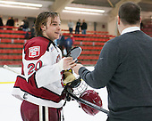 Ryan McGregor (Harvard - 20) - The Harvard University Crimson honored their seniors following their final home game of the regular season on Saturday, February 22, 2014 at the Bright-Landry Hockey Center in Cambridge, Massachusetts.