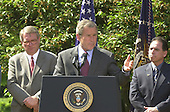 """United States President George W. Bush names John P. Walters to be the """"Drug Czar"""" in the Rose Garden of the White House in Washington, D.C. on May 10, 2001.  From left to right: John P. Walters, President George W. Bush, and Henry Lozano..Credit: Ron Sachs / CNP"""