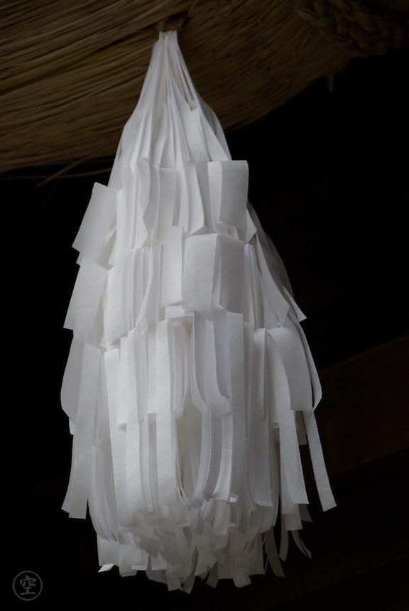 Sacred paper tassles, or gohei, hang from the rope cords at the Harumiya Taisha Suwa Shrine in Shimowsuwa, Nagano, Japan, April 12 2008