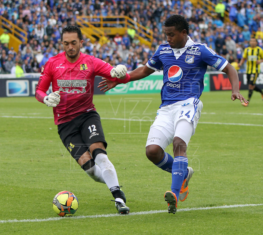 BOGOTA - COLOMBIA - 3 -06 -2013: Carlos Valencia  (Der) jugador de Millonarios , disputa el bal&oacute;n con Jerez  (Izq) de Alianza Petrolera   durante partido en el estadio Nemesio Camacho El Camp&iacute;n   de la ciudad de Bogot&aacute; , junio 3  de 2013. partido por la  fecha Diez y ocho de la Liga Postobon I. (Foto: VizzorImage / Felipe Caicedo / Staff).  Carlos Valencia (Right) Millonarios player, fights for the ball with Jerez (Left) of Alianza Petrolera  during party in the stadium Nemesio Camacho El Campin in Bogota, June 3, 2013. match the date of Eighteen postobon  League I.<br /> VizzorImage / Felipe Caicedo / Staff