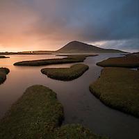Bust of light over Ceapabhal and coastal marsh, Northton - An Taobh Tuath, Isle of Harris, Scotland