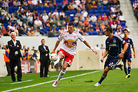 Kenny Cooper (33) of the New York Red Bulls plays the ball as Austin Berry (22) of the Chicago Fire defends during a Major League Soccer (MLS) match at Red Bull Arena in Harrison, NJ, on October 06, 2012.