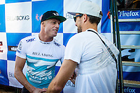 PIPELINE, Oahu, Hawaii (Tuesday, December 10, 2013) Mick Fanning (AUS) and injurgered Kieren Perrow (AUS) .   - The 2013 Billabong Pipe Masters in Memory of Andy Irons resumed today in six foot (2 metre) barrels and there was no shortage of drama in the ASP World Title race between Mick Fanning (AUS), 32, and Kelly Slater (USA), 41. There was also a shift in the Vans Triple Crown of Surfing Rankings as well as qualification developments for the 2014 WCT.<br /> <br /> The Billabong Pipe Masters represents the pinnacle of the 2013 ASP World Championship Tour, deciding the ASP World Title, Vans Triple Crown of Surfing, and final slots for 2014 ASP WCT qualification.<br /> <br /> Mick Fanning, two-time ASP World Champion and current No. 1, dominated his Round 3 clash with wildcard Kaimana Jaquias (HAW), 20, but unexpectedly erred in his three-man Round 4 heat against John John Florence (HAW), 21, and Nat Young (USA), 22. A last minute paddle battle with heat leader Florence in the closing seconds of the match took him from second to third and now pits him against one of the best Pipeline surfers in the world: C.J. Hobgood (USA), 34, in Round 5. Meanwhile, Slater skips Round 5 and heads straight to the Quarterfinals after his Round 4 win.<br /> <br /> Clearly disappointed with his misstep, Fanning couldn&rsquo;t leave the beach fast enough and wasn&rsquo;t prepared to talk about how this affects his approach to the final day of competition.<br /> <br /> Kelly Slater was electric in his bid for a historic 12th ASP World Title, earning the high heat-totals of both Round 3 and 4. Slater tore past Mitch Crews (AUS), 23, with a 17.66 out of 20 heat total for incredible Pipeline and Backdoor barrels and backed up the performance with a 17.50 out of 20 in Round 4.<br /> Photo: joliphotos.com