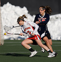 Grace Gaeng (5) of Maryland tries to make her way past Ryan Ball (10) of Richmond at the practice turf field in College Park, Maryland.  Maryland defeated Richmond, 17-7.