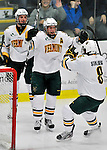 2 December 2011: University of Vermont Catamount forward H.T. Lenz (center), a Sophomore from Vienna, VA, celebrates a second period UVM goal against the University of Maine Black Bears at Gutterson Fieldhouse in Burlington, Vermont. The Catamounts fell to the Black Bears 6-4 in the first game of their 2-game Hockey East weekend series. Mandatory Credit: Ed Wolfstein Photo