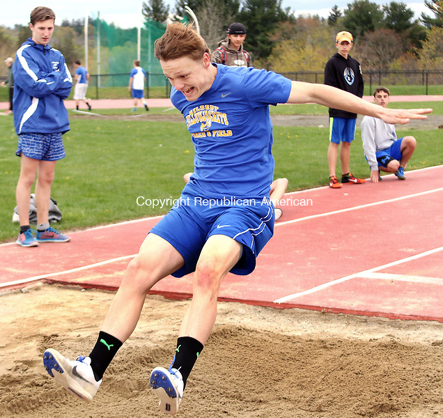 LITCHFIELD CT. 09 May 2017-050917SV11-Evan Jackson of Gilbert competes in the long jump during a track meet against Litchfield High and Nonnewaug High in Litchfield Tuesday. <br /> Steven Valenti Republican-American