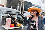 JENNY MOSCO, of Plainview, wears a straw and feather Easter Bonnet, as she strikes a pose in front of 1951 Studebaker with snack tray attached outside front passenger window, at the 58th Annual Easter Sunday Vintage Car Parade and Show sponsored by the Garden City Chamber of Commerce. Hundreds of authentic old motorcars, 1898-1988, including antiques, classic, and special interest participated in the parade.