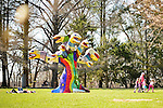 Roslyn, New York, U.S. - April 12, 2014 - During International Slow Art Day, visitors view Snake Tree, a mixed media outdoor sculptural installation 18' high, by Niki de Saint Phalle, and other artwork at the Nassau County Museum of Art on Long Island. During this annual worldwide event, those participating went to local museums and viewed a small number of works of art, each for at least 10 minutes, and then discussed them afterward.