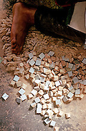 March 5, 1989, Casablanca, Morocco. Zelige making is a Moroccan artcraft widely used for the decoration of Hassan II Mosque. Small pieces of ceramic tiles are cut and put together in a vast variety of geometrical patterns to form the final piece.