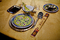 A place setting in the most expensive 'VIP' room at The West Lake Restaurant. Able to seat up to 5,000 people at one sitting, The West Lake Restaurant is the biggest Chinese restaurant in the world. Each week its diners, who staff are taught are 'the bringers of good fortune', devour 700 chickens, 200 snakes, 1,200 kgs of pork and 1,000 kgs of chillis. Its 300 chefs cook in five kitchens and its staff total more than 1,000.It is fully booked most nights.