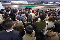 Commuters crowd the platform waiting to get on the train. Tokyo has one of the most extensive and efficient transport networks in the world - but also one of the most crowded. Rail companies calculate crowding by percent of standard capacity (ie when all the seats and standing spaces are occupied). Some trains reach 220%+.
