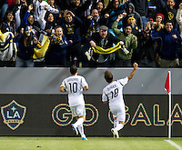 CARSON, CA - November 11, 2012: LA Galaxy players Landon Donovan (10) and Mike Magee (18) celebrate Magee's goal with the fans during the LA Galaxy vs the Seattle Sounders at the Home Depot Center in Carson, California. Final score LA Galaxy 3, Seattle Sounders 0.