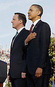 United States President Barack Obama welcomes British Prime Minister David Cameron during an official arrival ceremony at the South Lawn of the White House March 14, 2012 in Washington, DC. Prime Minister Cameron was on a three-day visit in the U.S. and he was expected to have talks with President Obama on the situations in Afghanistan, Syria and Iran. .Credit: Chip Somodevilla / Pool via CNP