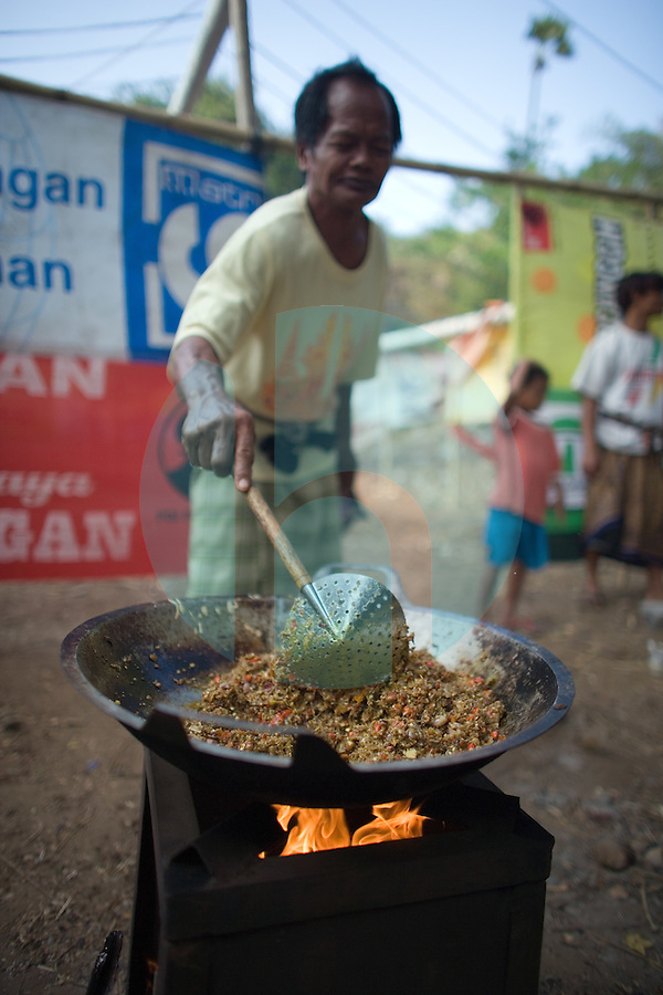 September 9th 2007- Bali, Indonesia- In preparation for a wedding, man cooks a hot chili sauce over an open fire in an area known as Jemeluk Bay, which is located near the Amed area of North East Bali. Photograph by Daniel J. Groshong/Tayo Photo Group