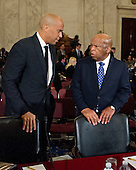 United States Senator Cory Booker (Democrat of New Jersey), left, and US Representative John Lewis (Democrat of Georgia) speak prior to appearing on a panel testifying before the United States Senate Judiciary Committee on the nomination of US Senator Jeff Sessions (Republican of Alabama) to be Attorney General of the United States on Capitol Hill in Washington, DC on Wednesday, January 11, 2017.  Senator Booker became the first sitting senator in US history to testify against a fellow sitting senator at a cabinet confirmation hearing.<br /> Credit: Ron Sachs / CNP