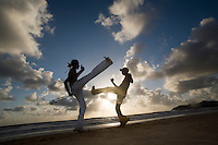 """Capoeira, a Brazilian martial art that combines elements of dance, acrobatics and music, and is usually referred to as a game - known for quick and complex moves, using mainly power, speed, and leverage for a wide variety of kicks, spins, and highly mobile techniques - On 26 November 2014 capoeira was granted a special protected status as """"intangible cultural heritage"""" by UNESCO. Ponta Negra beach, Natal city, Rio Grande do Norte State, Brazil."""