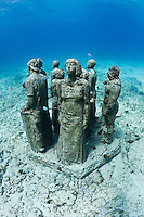 RG40558-D. underwater sculpture garden called The Silent Evolution, made by artist Jason de Caires Taylor. Part of the Museo Subacuatico de Arte, these cement sculptures number in the hundreds and rest in 25 feet of water off Isla Mujeres and depict real people, including many locals from the Cancun area. Made using special materials which encourage colonization by coral and other invertebrate marine life, and also attract tropical fish species. One goal of this installation is to help form an artificial reef which will reduce tourist pressure on nearby natural reefs.  Mexico, Gulf of Mexico, Caribbean Sea.<br /> Photo Copyright &copy; Brandon Cole. All rights reserved worldwide.  www.brandoncole.com
