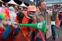 a crowd of fans blow vuvuzuelas at the Cape Town fan walk before the 2010 FIFA World Cup semi-final between the Netherlands and Uruguay at Greenpoint Stadium in Cape Town, South Africa on Tuesday, July 6, 2010.  Netherlands defeated Uruguay 3-2.