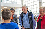 "Oct 4, 2012 - GARDEN CITY, NEW YORK U.S. - (L - R) THOMAS MORAN 11, of Wantagh (from behind), talks with Nassau County Legislator CARRIÉ SOLAGES; Mercury astronaut SCOTT CARPENTER; and Congresswoman CAROLYN MCCARTHY at the entrance to the new JetBlue Sky Theater Planetarium at Cradle of Aviation Museum. Then Nassau County students watched ""We Are Astronomers"" a digital planetarium show, and asked the astronaut questions. The planetarium, a state-of-the-art digital projection system, officially opens this weekend."