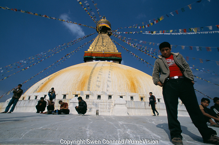 Bodhnath Stupa in Kathmandu, Nepal. Situated on an early trade route between Kathmandu and Lhasa, Bodhnath was a religious site as early as the 7th century. The present stupa, Nepals largest, was constructed probably in the 14th century. Since the invasion of Tibet by Chinese Communist troops in 1950, the migration of Buddhist refugees to Bodhnath has made this stupa and its surrounding monasteries a world center of Tibetan Buddhism.