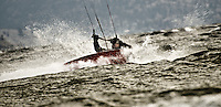 Artistic photograph of wild wind surfing action on the lake.
